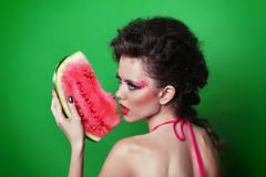 Beautiful young woman eating watermelon Royalty Free Stock Photography
