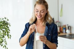 Free Beautiful Young Woman Eating Yogurt At Home. Stock Photography - 101495642