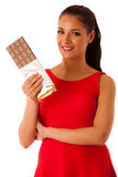 Beautiful young woman eats chocolate isolated over white backgro Stock Photo