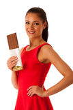 Beautiful young woman eats chocolate  over white backgro Stock Image