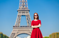 Beautiful young woman on the Eiffel Tower background Stock Photography