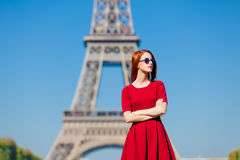Beautiful young woman on the Eiffel Tower background Stock Images