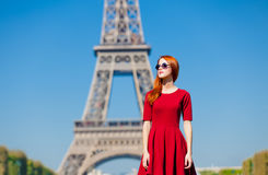 Beautiful young woman on the Eiffel Tower background Royalty Free Stock Photography
