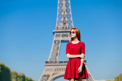 Beautiful young woman on the Eiffel Tower background Stock Image