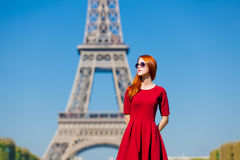 Beautiful young woman on the Eiffel Tower background Royalty Free Stock Images