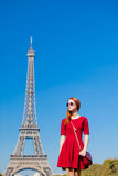 Beautiful young woman on the Eiffel Tower background Stock Photo