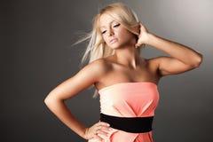 Beautiful young woman in elegance dress. Stock Image