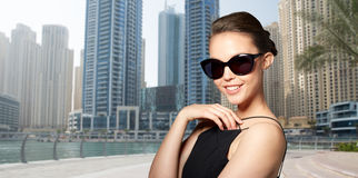 Beautiful young woman in elegant black sunglasses Royalty Free Stock Photo
