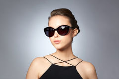 Beautiful young woman in elegant black sunglasses Stock Photo