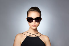 Beautiful young woman in elegant black sunglasses Stock Image
