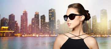 Beautiful young woman in elegant black sunglasses Royalty Free Stock Image