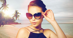 Beautiful young woman in elegant black sunglasses Stock Photography