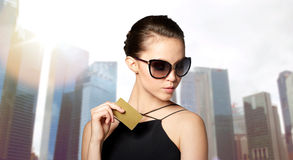 Beautiful young woman in elegant black sunglasses Royalty Free Stock Photography