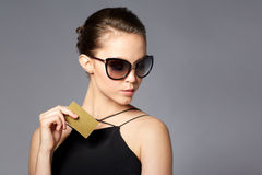 Beautiful young woman in elegant black sunglasses Royalty Free Stock Photos
