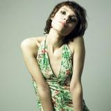 Beautiful young woman in elegant dress Stock Photos