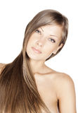 Beautiful young woman with elegant long shiny hair Royalty Free Stock Image