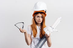 Beautiful young woman engineer on white  background holds blueprints Royalty Free Stock Photo