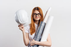 Beautiful young woman engineer on white isolated background holds blueprints Stock Photography