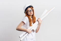 Beautiful young woman engineer on white isolated background holds blueprints Royalty Free Stock Images
