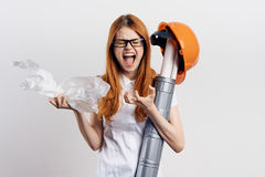 Beautiful young woman engineer on white isolated background holds blueprints Royalty Free Stock Photos