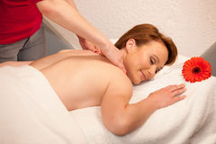 Beautiful young woman enjoing a massage treatment in wellness Royalty Free Stock Images
