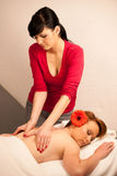 Beautiful young woman enjoing a massage treatment in wellness Royalty Free Stock Photography