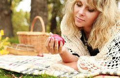 Beautiful young woman enjoy with ripe apple Stock Images