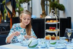 Beautiful young woman enjoying afternoon tea Stock Photo