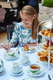 Beautiful young woman enjoying afternoon tea Royalty Free Stock Image