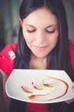 Beautiful young woman enjoying a delicious seafood Royalty Free Stock Image