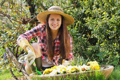 Beautiful young woman enjoying her garden Stock Photos