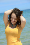 Beautiful young woman enjoying her summer vacation Royalty Free Stock Photos