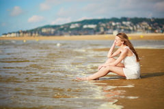 Beautiful young woman enjoying her vacation by ocean or sea Stock Photo