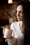 Beautiful young woman enjoying latte coffee Stock Photography