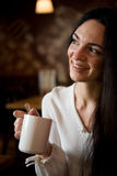 Beautiful young woman enjoying latte coffee Royalty Free Stock Image