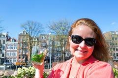 Beautiful young woman enjoying a mint tea in Amsterdam Stock Photos