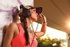 Beautiful young woman enjoying the music Royalty Free Stock Images