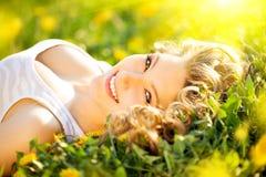Beautiful young woman enjoying nature stock images