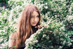 Beautiful young woman enjoying smell Stock Photography