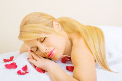 Beautiful young woman enjoying spa treatment Stock Photography