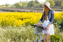 Beautiful young woman enjoying spring in a field. Royalty Free Stock Photography
