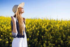 Beautiful young woman enjoying spring in a field. Stock Image