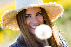 Beautiful young woman enjoying spring in a field. Royalty Free Stock Images