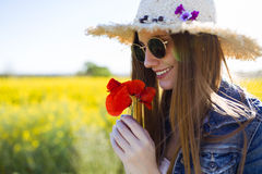 Beautiful young woman enjoying spring in a field. Stock Photography
