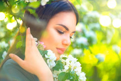 Beautiful young woman enjoying spring nature Royalty Free Stock Image