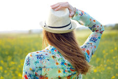 Beautiful young woman enjoying summer in a field. Royalty Free Stock Image