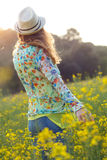 Beautiful young woman enjoying summer in a field. Royalty Free Stock Images