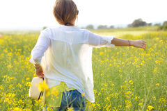 Beautiful young woman enjoying summer in a field. Royalty Free Stock Photos