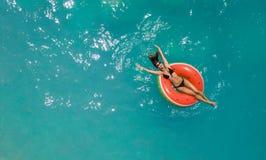 Beautiful young woman enjoying summer at the sea stock image