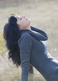 Beautiful young woman enjoying sun in fall Stock Photography